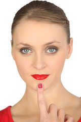 woman with red lipstick and red polished nails