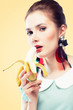 Retro styled woman eating banana