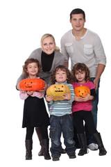 Family with Halloween jack-o'-lanterns