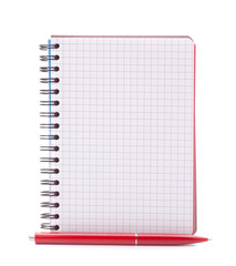Open blank checked notebook with red pen