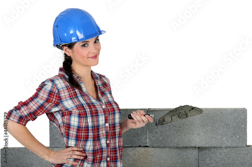 female mason applying cement