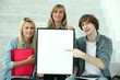 Three students holding a board left blank for your image