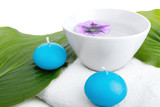 white towel water cup flower candles and leaves, spa concept
