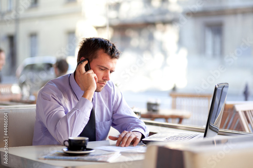 Authentic image of a businessman working in a coffee shop