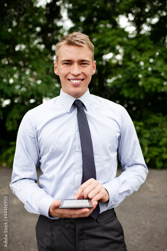 Young businessman with ebook reader