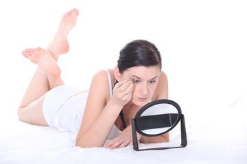 Woman applying eyeshadow