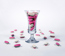 Pink tablests - pills in a glass