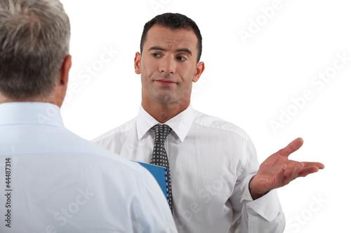 Businessman explaining point to colleague