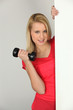 Young woman with a dumbbell