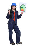 Female electrician with an energy rating card