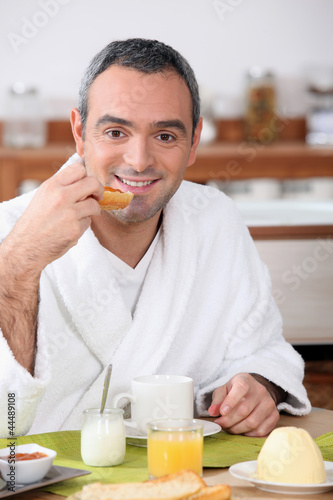 Man eating breakfast in your bathrobe
