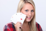 Girl showing cards