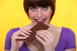Gourmand woman eating chocolate