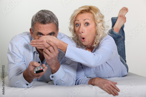 Woman trying to block her husband's view