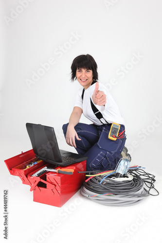 female electrician, thumbs up