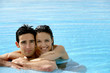 beautiful couple in a swimming pool