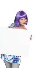 Purple-haired woman showing us a board.