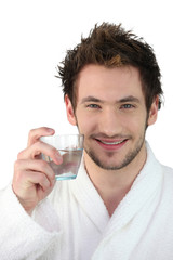 Young man with a glass of water