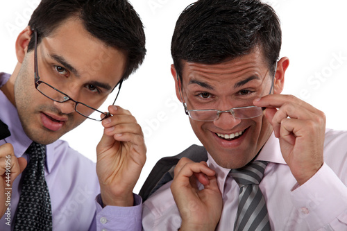 duo of executives with glasses lowered