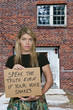 Woman Holding a Sign