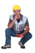 A kneeled plumber.