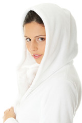 Portrait of young beautiful woman in bathrobe