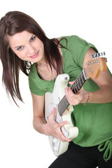 Young woman rocking a guitar