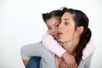 Child riding piggyback