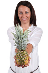 Smiling woman showing pineapple