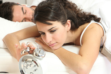 Woman turning off alarm