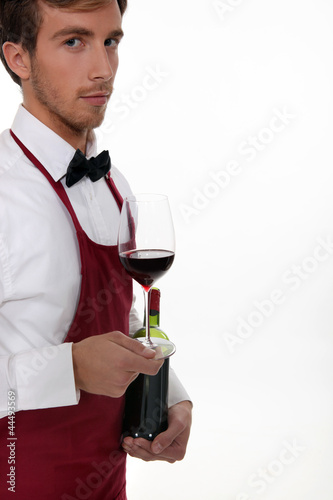 Sommelier serving a bottle of wine