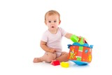 Lovely baby girl playing with toys
