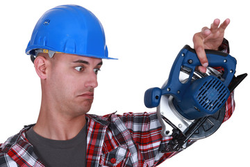 Builder holding circular-saw