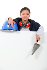 Little girl dressed as manual worker