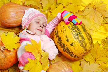 Girl with pumpkins