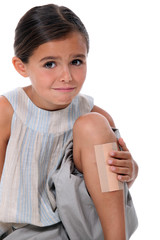 Young girl with an enormous plaster on her leg
