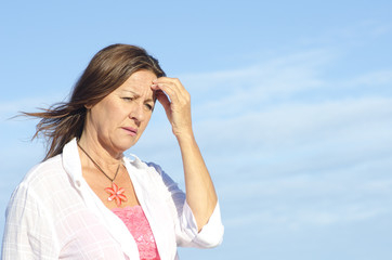 Thoughtful worried senior woman isolated