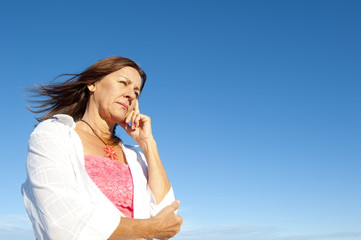 Worried depressed woman sky background