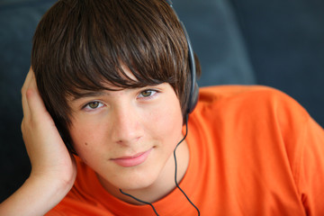 Teenager listening to music on headphones