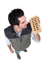 Builder holding brick