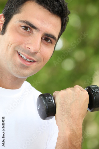 Man lifting light weights