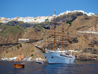 Anchored sailboat in the flooded caldera of Santorini