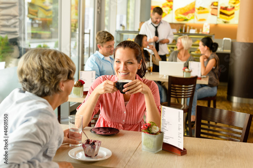 Leinwandbild Motiv Senior woman with her daughter at cafe
