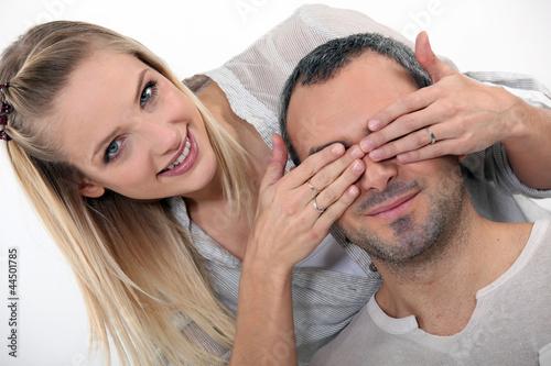 woman surprising her boyfriend