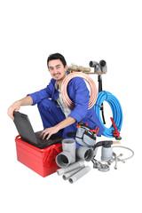 plumber preparing his equipment and his laptop