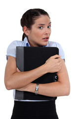 Worried woman holding folder
