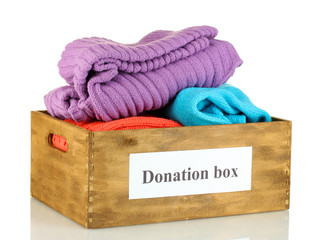 Donation box with clothing isolated on white