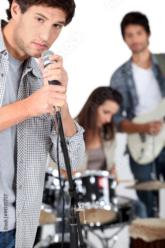Young man singing in a band