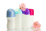 deodorants with flowers isolated on white