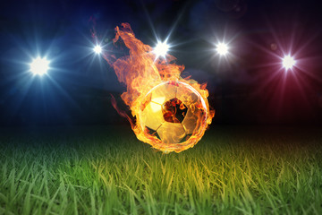 Fussball in Flammen auf Spielfeld 3D